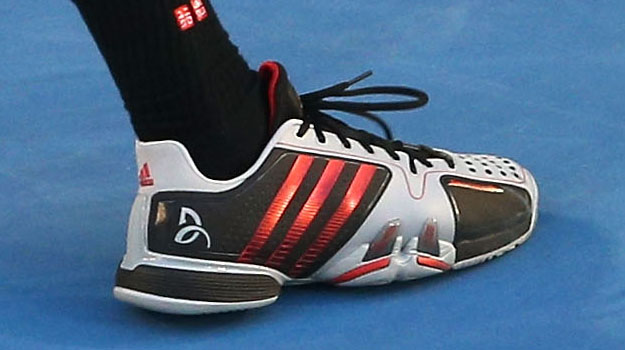Novak in Adidas Barricade 7 Novak Black/Scarlett