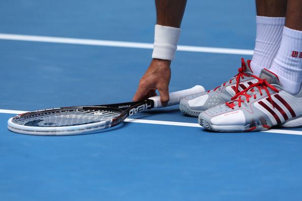 Novak Djokovic sports the new Adidas Barricade 7 in White/Scarlett